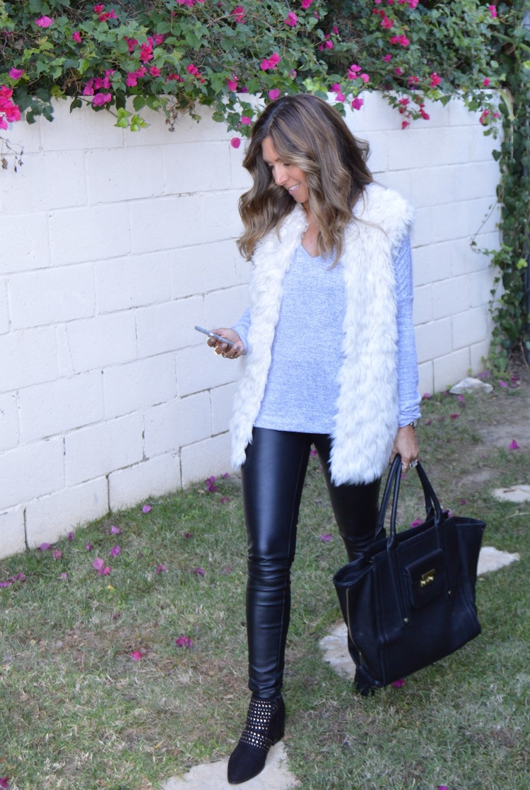 Blank NYC faux leather pants ,  Rag and Bone Sweater ,  white faux fur vest ,  Top Shop studded boots ,  Phillip Lim bag