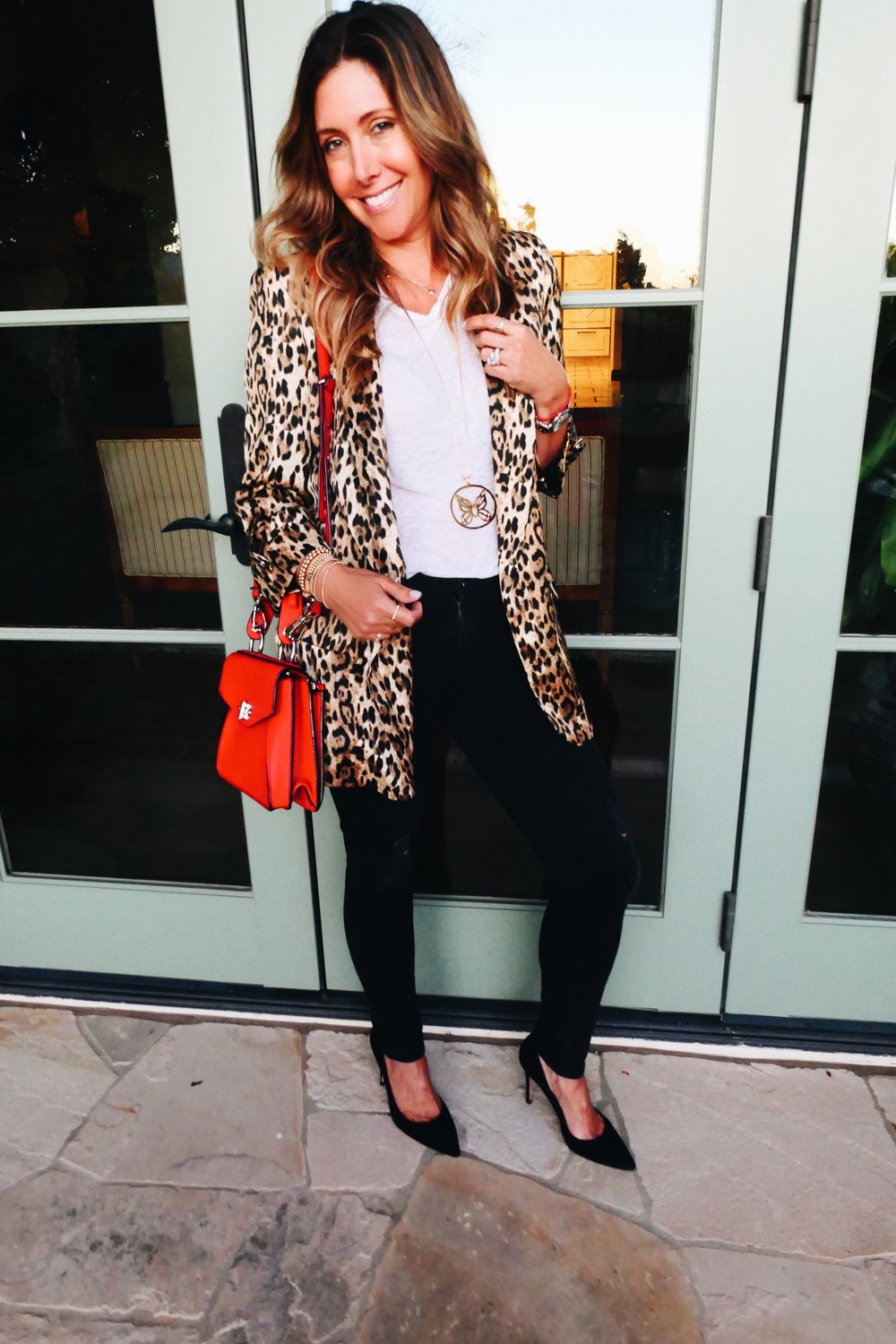 White Tee:  Isabel Marant  | Leopard Blazer: Zara, similar  here  | Jeans:  Adriano Goldschmied  | Pumps:  Gianvito Rossi  | Red Bag: Proenza, similar  here