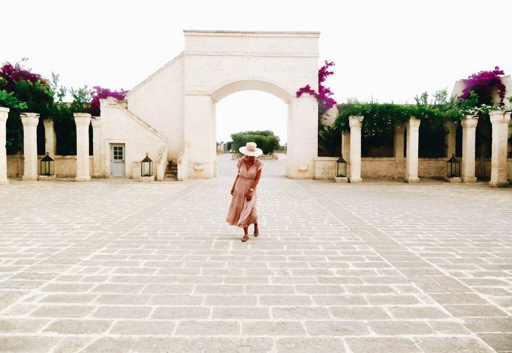 Entrance at the  Borgo Egnazia , Puglia. Dress by Ulla Johnson.  Similar here