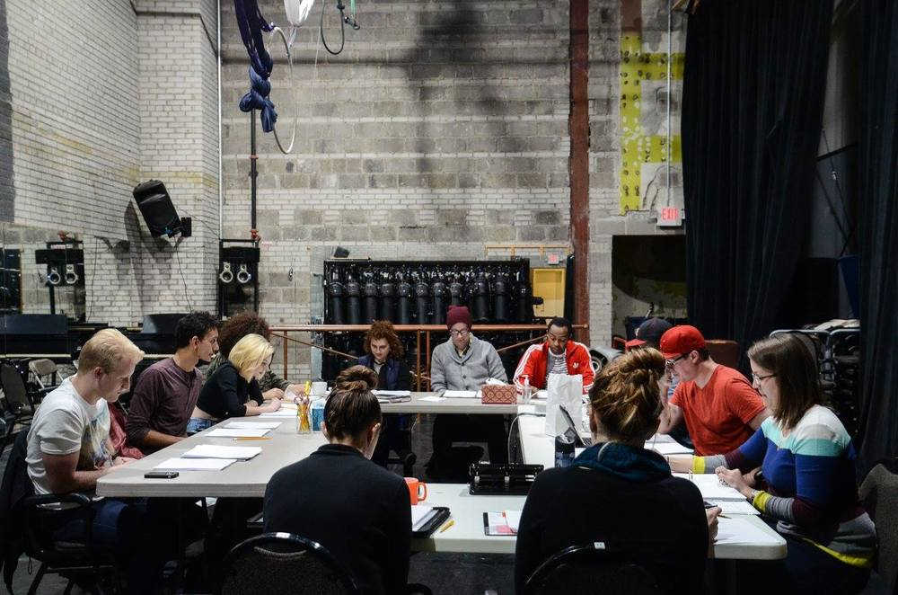 Actors and crew reading the new edits during rehearsal | Photography by Theater Latte' Da