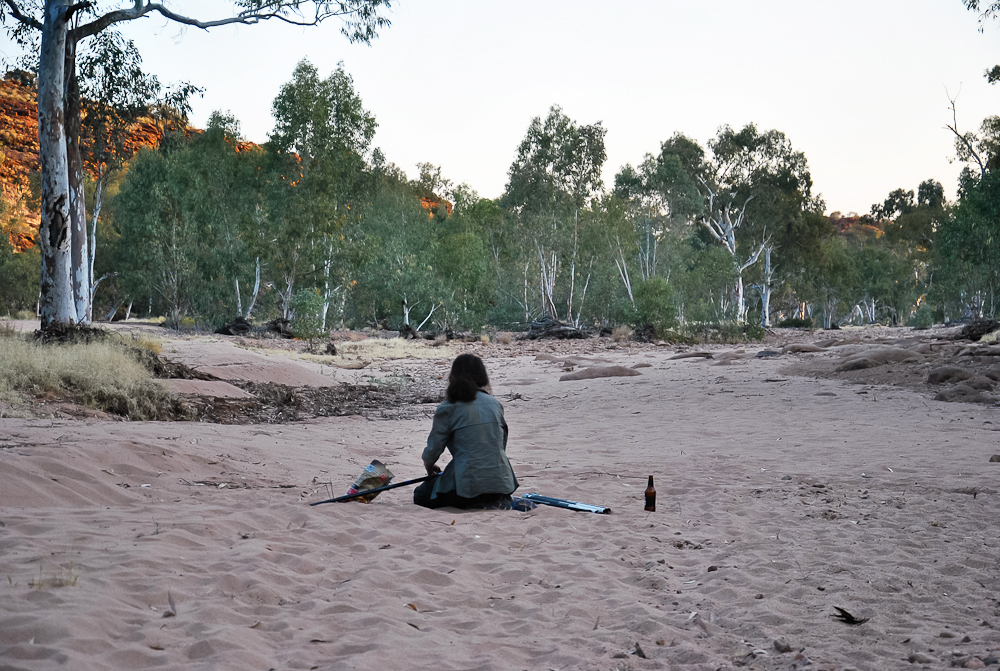 "Rebecca Sullivan, one of my volunteers, fixing dragon nooses in the middle of the Finke ""River""."