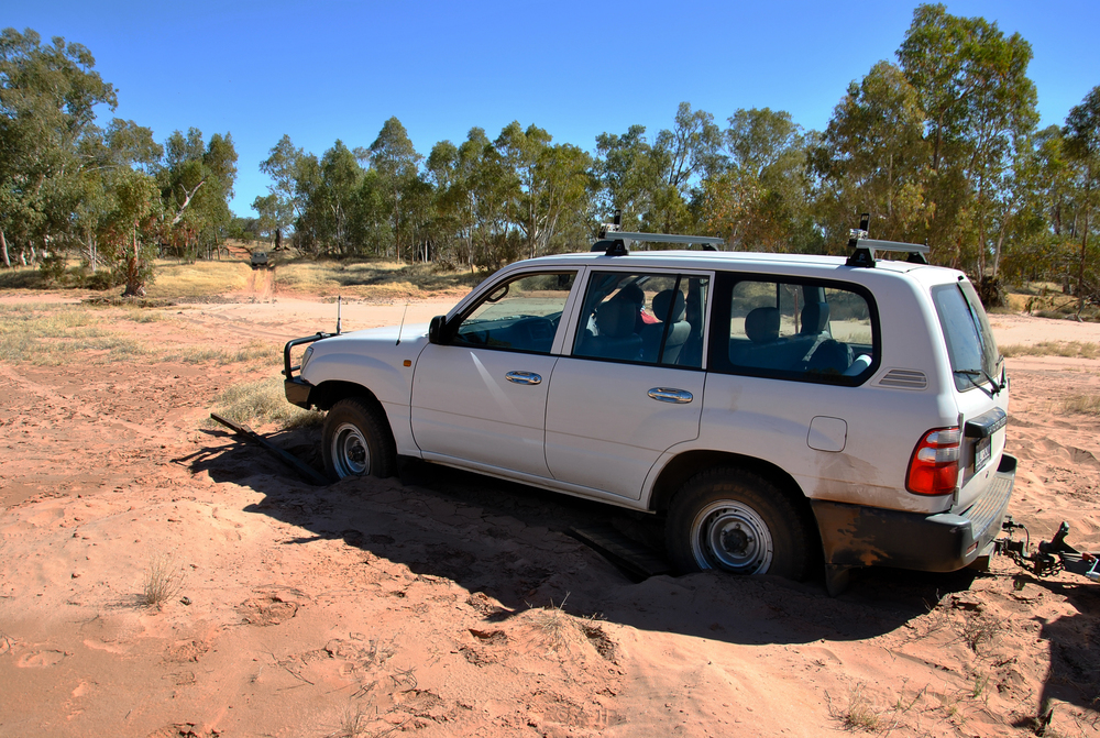 The station manager's Hilux was the first to be freed and get across the Finke.