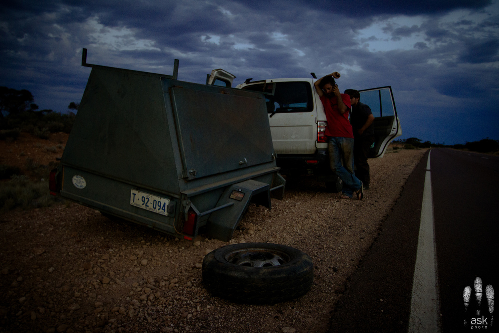 Our trailer lost its wheel while we were going 110 km/h down the Stuart Highway. I still don't know why this happened. Photo by Angus Kennedy. From  this post .