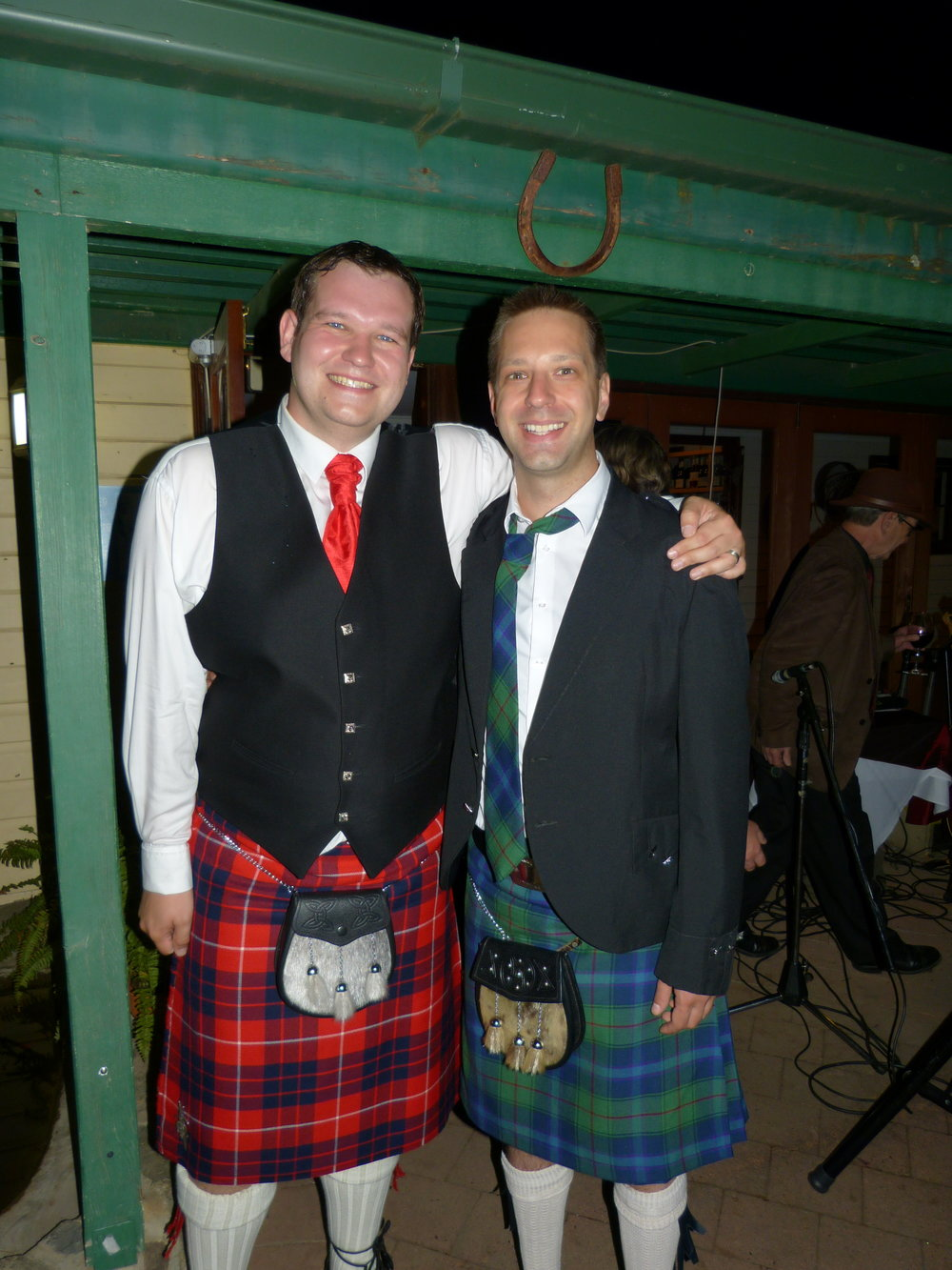 Dave (L) and me (R) wearing kilts at Dave's wedding. This was my first (and only) kilt-wearing experience.