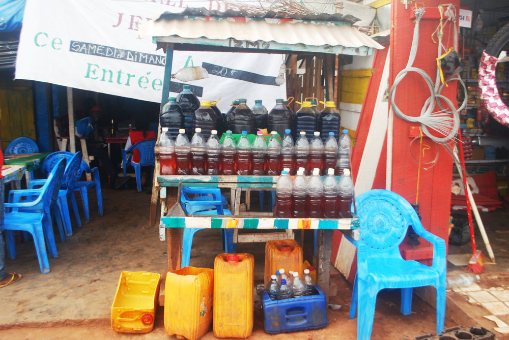 A gas station on the main road near Boali Falls. Gasoline is purchased in Bangui, driven up the highway in gas canisters, and partitioned into minuscule amounts in water bottles for sale to those unlucky enough to run out of fuel before reaching Bangui. The entrance to the restaurant where we had lunch is visible on the left.