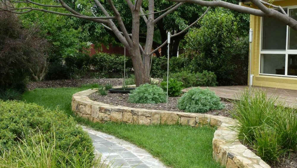 Watson Residence   A large block for keen gardeners who were looking to achieve a series of linked spaces surrounding their modest residence. The garden spaces now provide for every mood and every occasion. Strong use of natives gives an intriguing example of an urban oasis.