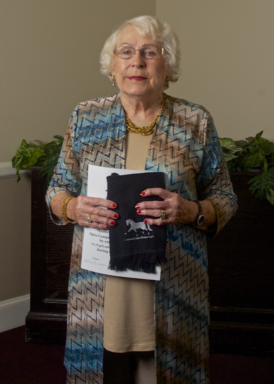 Sally Briney with one of Paula Briney's awards