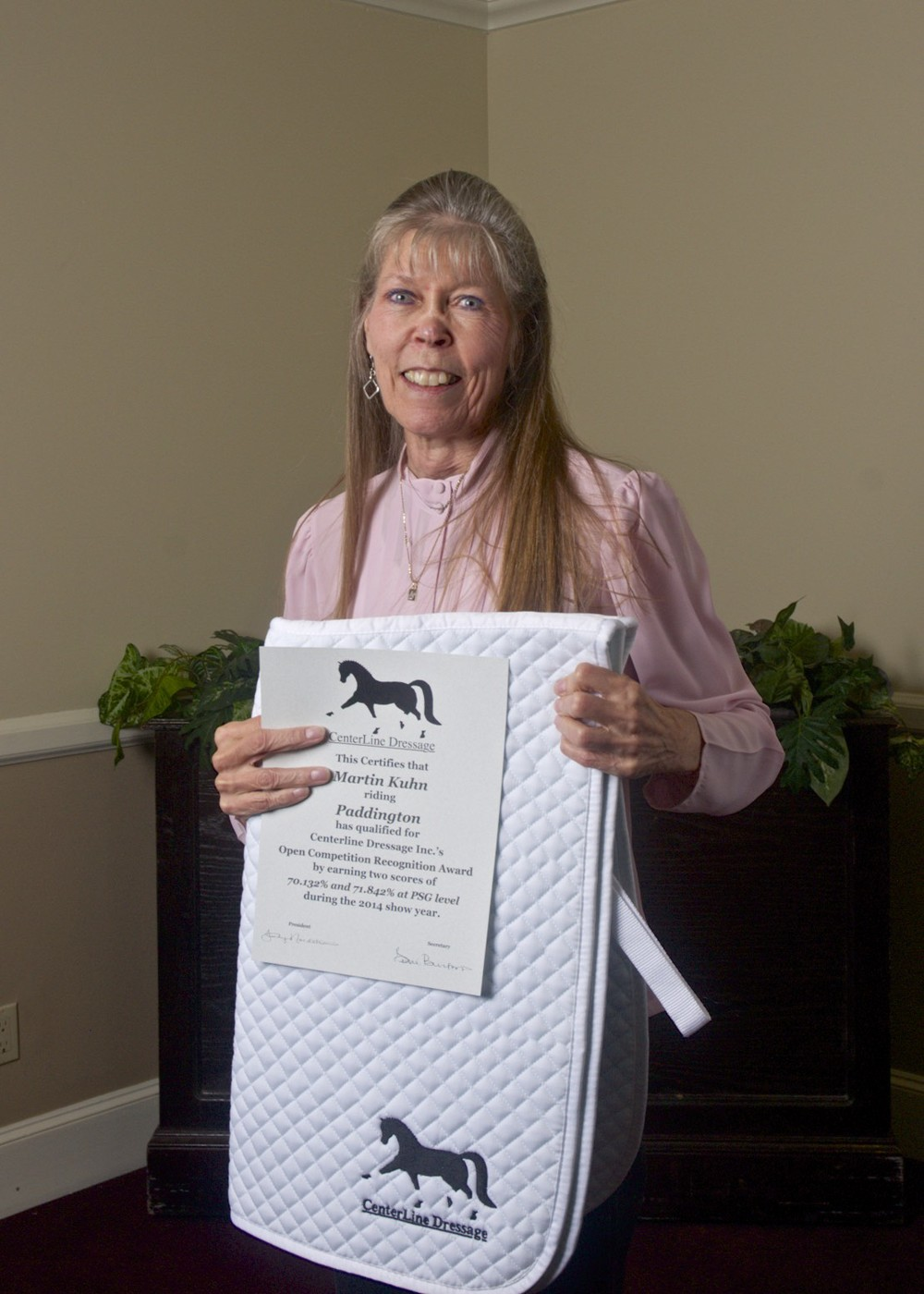 Leslie Burket with one of her awards