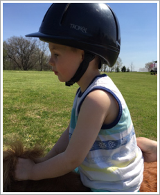 President Nordstrom's grandson Roman Parker on Easter riding Spirit. Next year leadline classes!