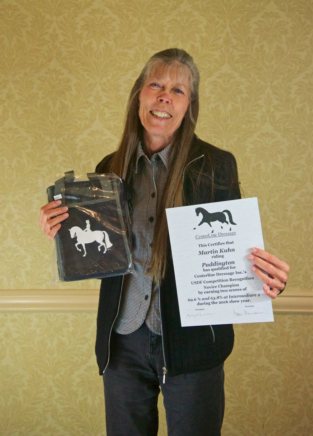 Owner Leslie Burket receiving her Intermediare II Novice Champion Award