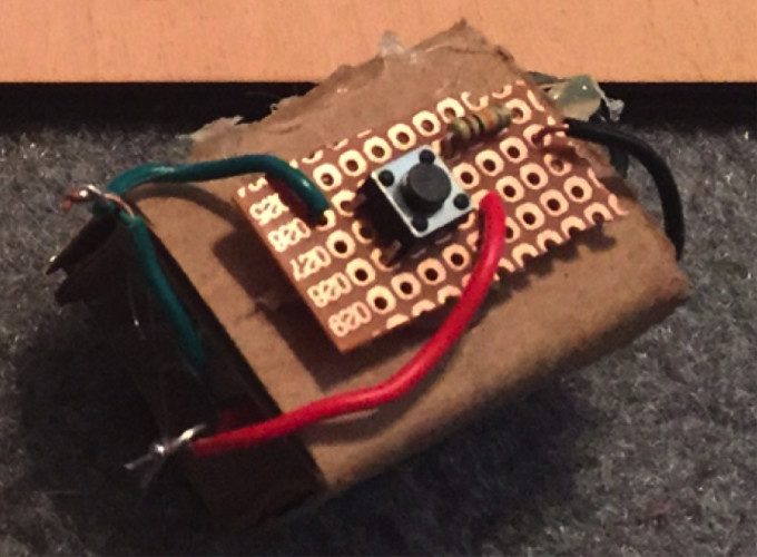 The first Bleepy McProtoboard component was made from cardboard, scrap wire and electronic parts, and hot glue.