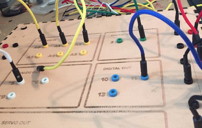 The surface of Bleepy McProtoboard with patch cords made from shoelaces and alligator plugs.