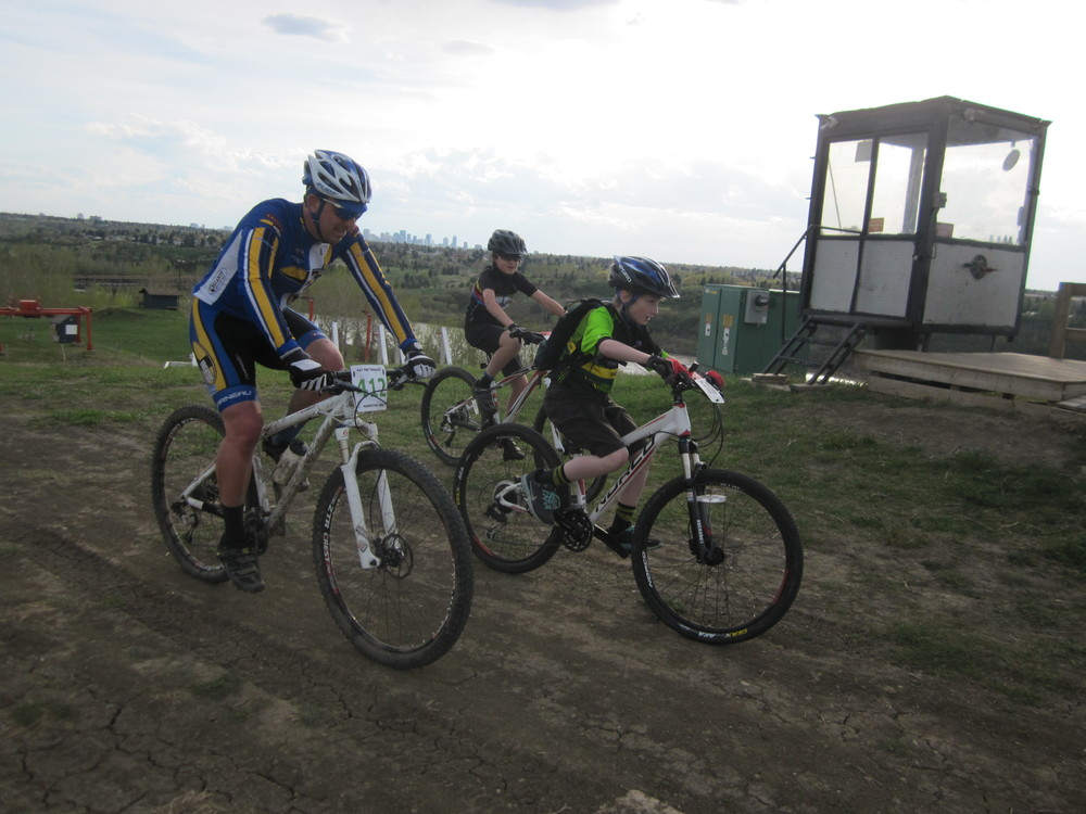 Sprockids blasting past Coach Greg at the top of the climb!
