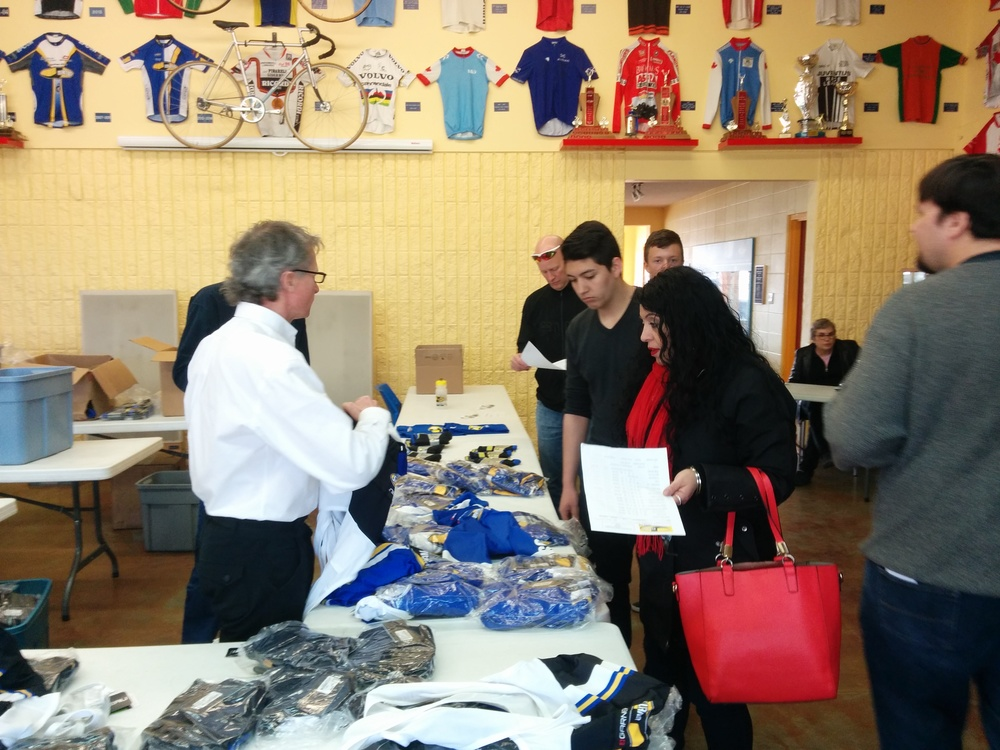John assists with choosing the jersey.