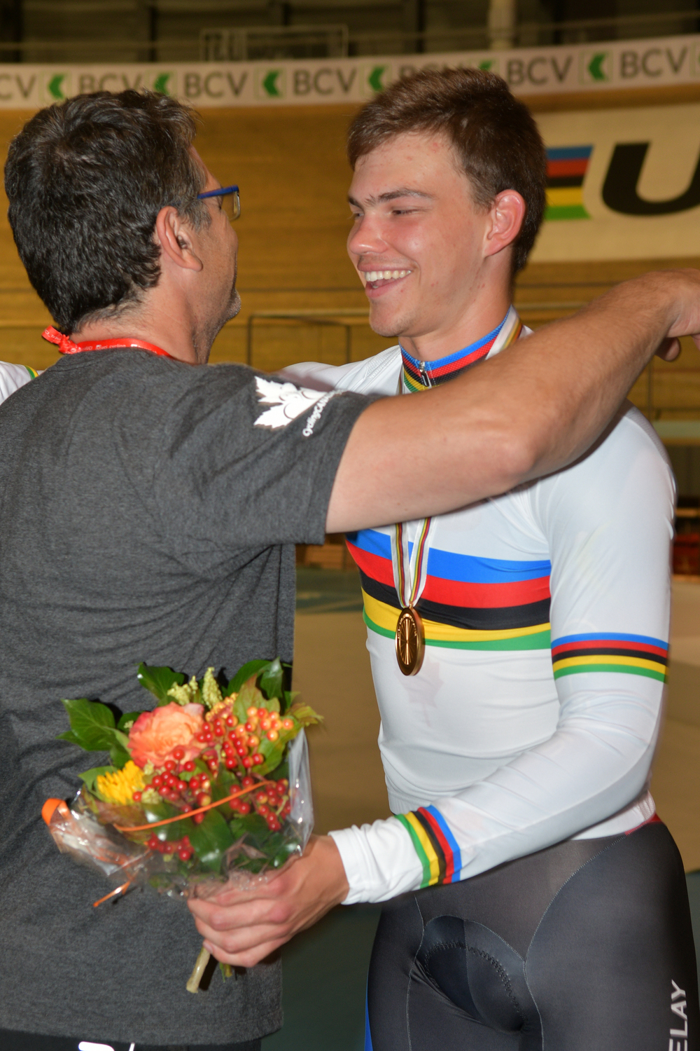 Sharing the victory with his coach - Stefan and Alex