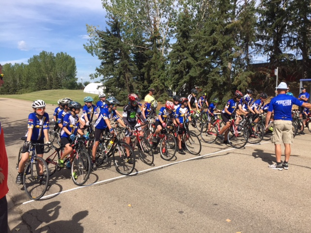 LAMP Director Bill Burtnik gives riders final instructions before the Edmonton Research Park Crit.