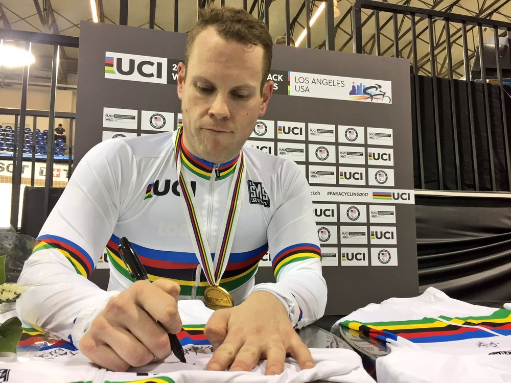 Ross Wilson signing his first (but not only) championship jersey of the 2017 Para World Track Cycling Championships.