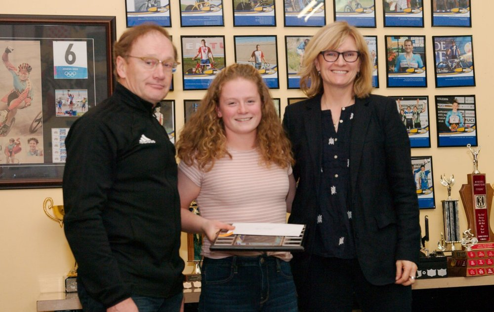 Dave Embury, along with Gail Wozny, present Ngaire Barraclough with the 2017 Argyll Velodrome Association Scholarship.