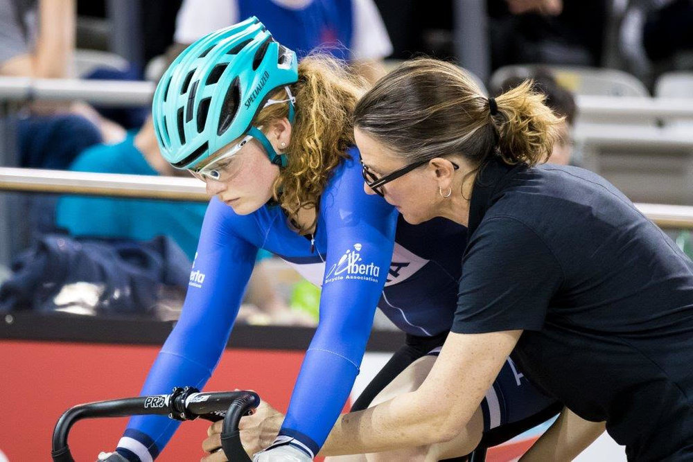 Alberta Provincial Coach Tanya Dubnicoff helps Ngaire get set for her Match Sprint final.