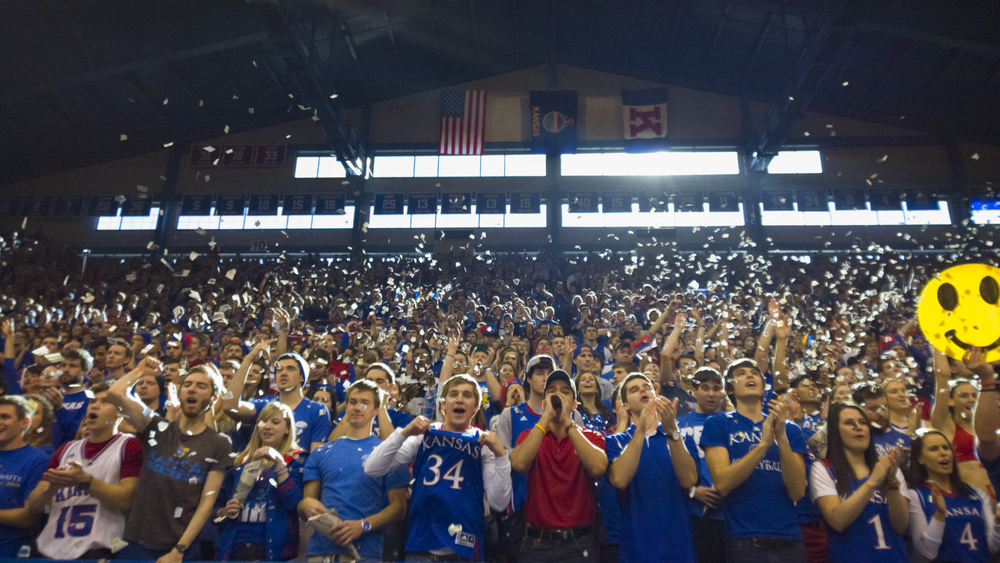 University of Kansas students toss confetti as the KU basketball team is announced before tip-off.