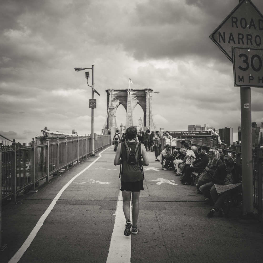 Across the bridge. Shot within the typical street photography range at 40mm.
