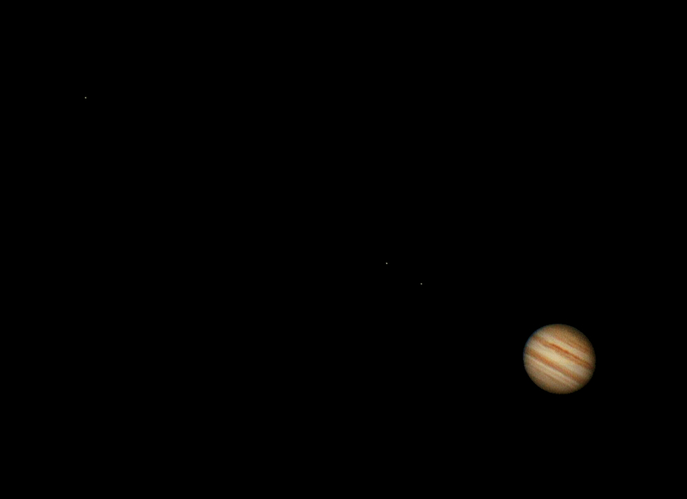 This is an image of Jupiter found in the bottom right. Ganymede,   Io, and Europa are the moons seen left to right.