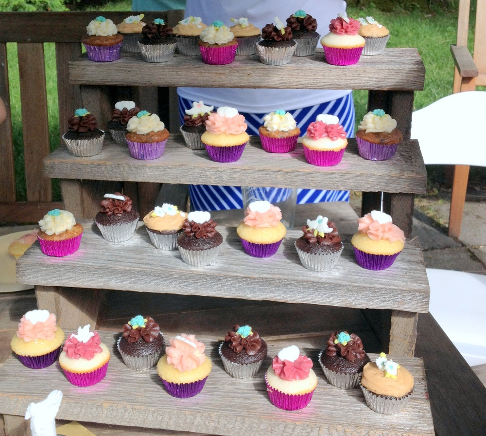 We re-purposed the stairs by placing mini cupcakes on them! They came from a sweet little cupcake place in Old Lyme, CT that my mom discovered. Delish! We also had an entire ice cream sundae bar, but people were too busy eating that to take pics!