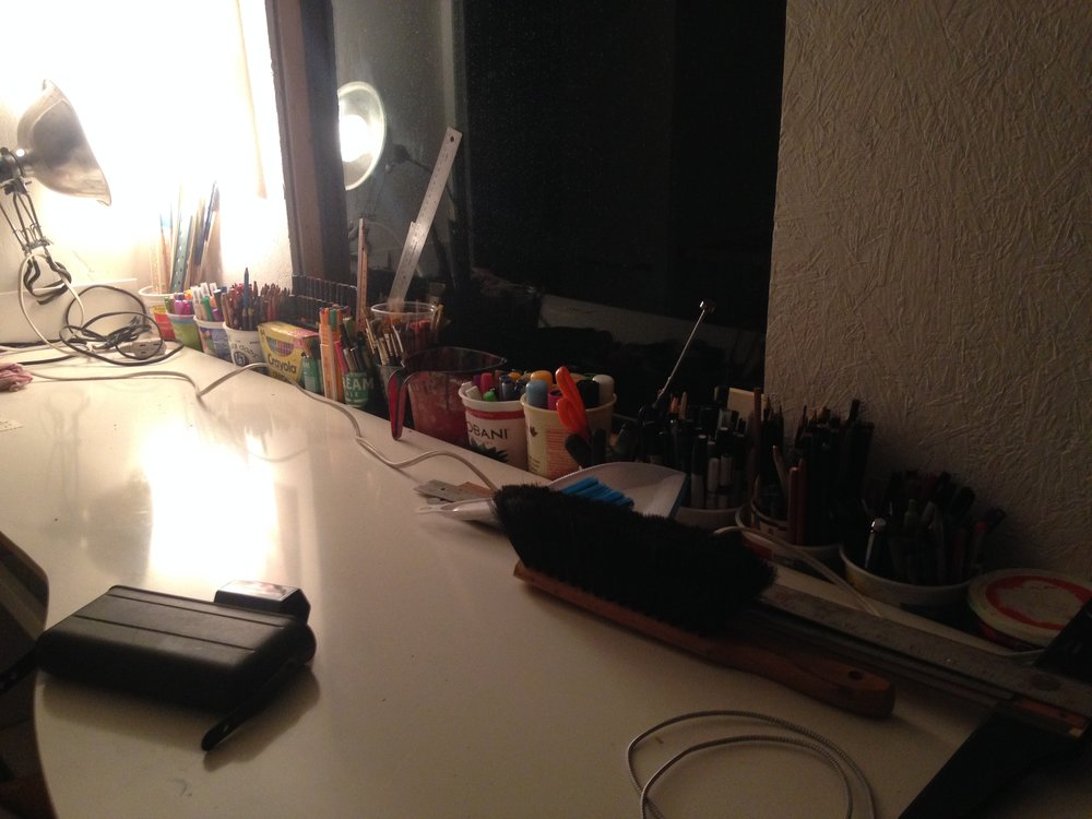 Bonus junky picture of all my pens/markers/etc lined up behind the desk! And my batteries powering a light for some nighttime obsessive organization of pens/markers/etc!