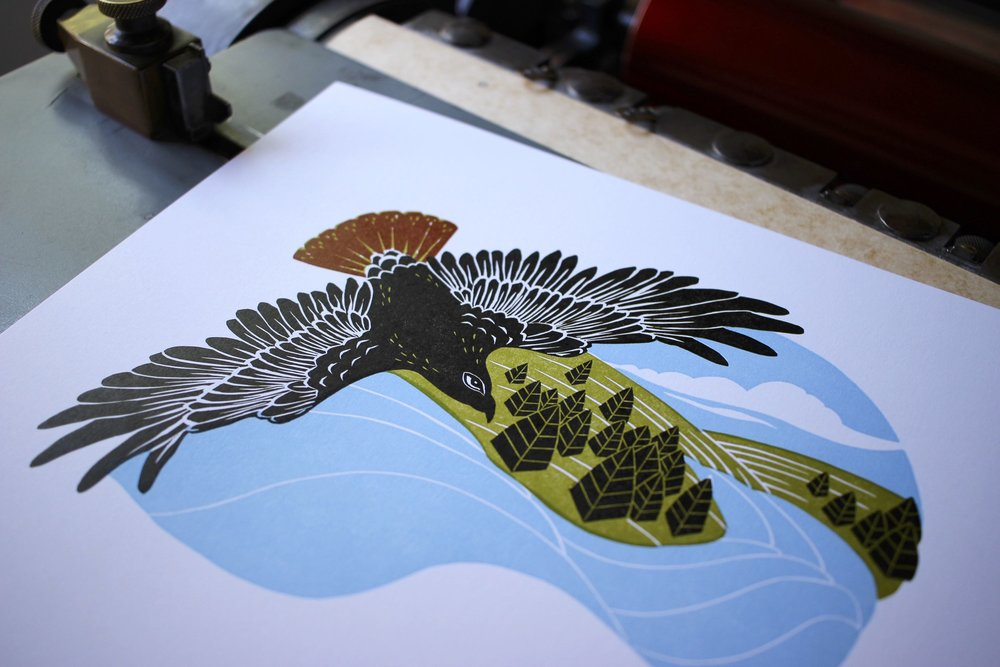 Letterpress printed 2017 poster calendar with red-tailed hawk linocut print.