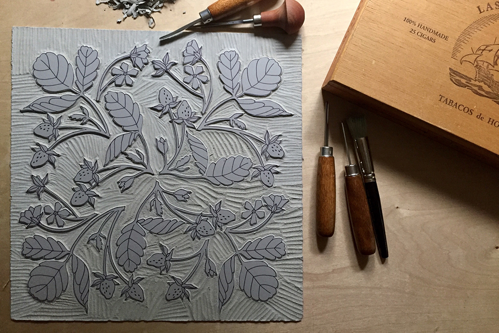 Finished linocut block of wild strawberry pattern
