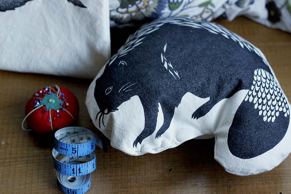 Block printed beaver shaped pillow