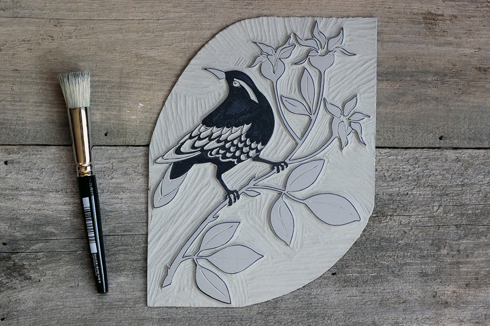 Varied Thrush linocut block finished