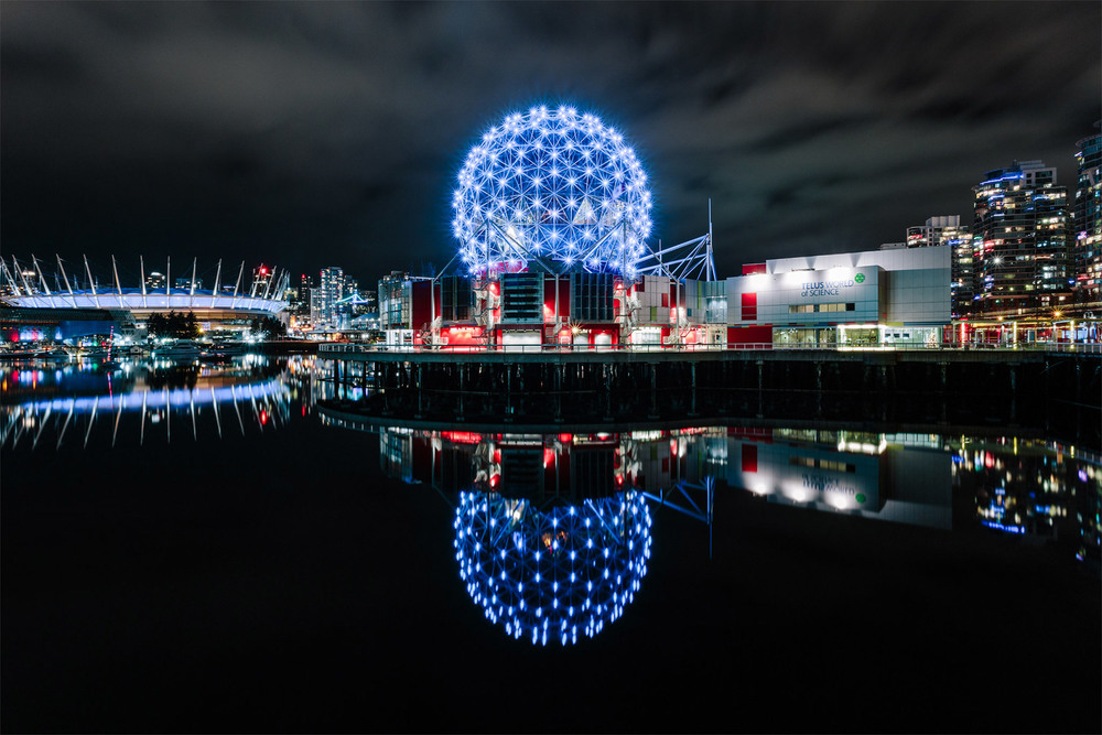 Science World at TELUS World of Sceince in Vancouver, British Columbia with BC Place Stadium in the background