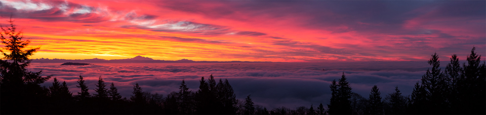Sunrise over a foggy Vancouver. Taken from Cypress Mountain Lookout, West Vancouver, B.C.