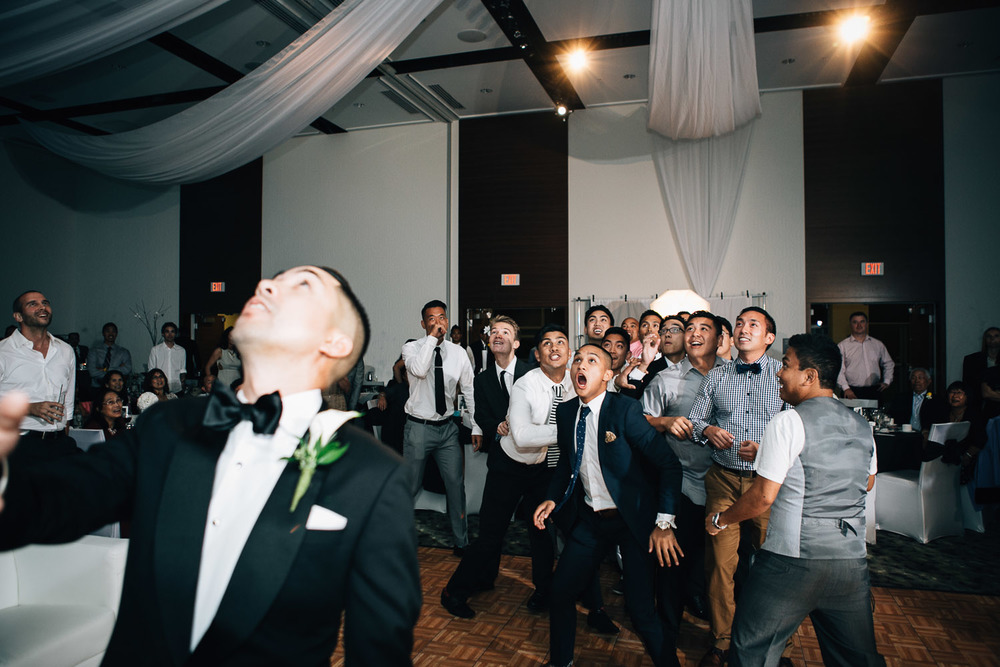 garter toss richmond wedding reception photography westin wall centre vancouver airport noyo creative