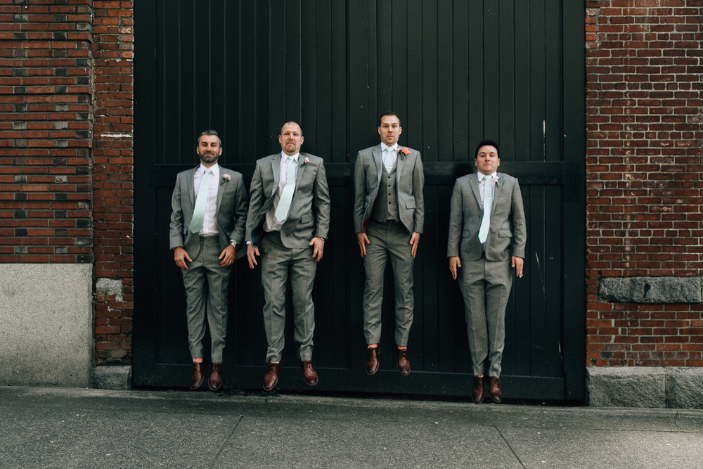 groomsmen fun in gastown vancouver wedding photographer