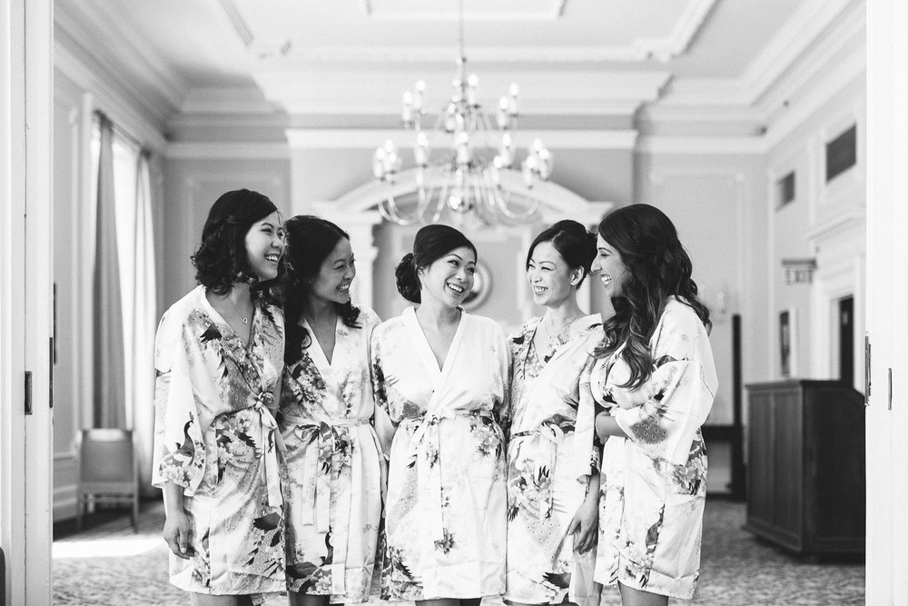 bridesmaids candid laughing at the vancouver club in coal harbour wedding photography