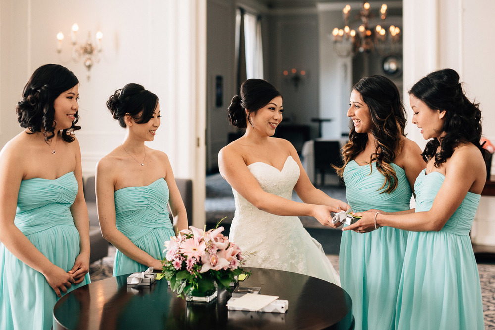 bride giving presents to bridesmaids at the vancouver club in coal harbour wedding photography
