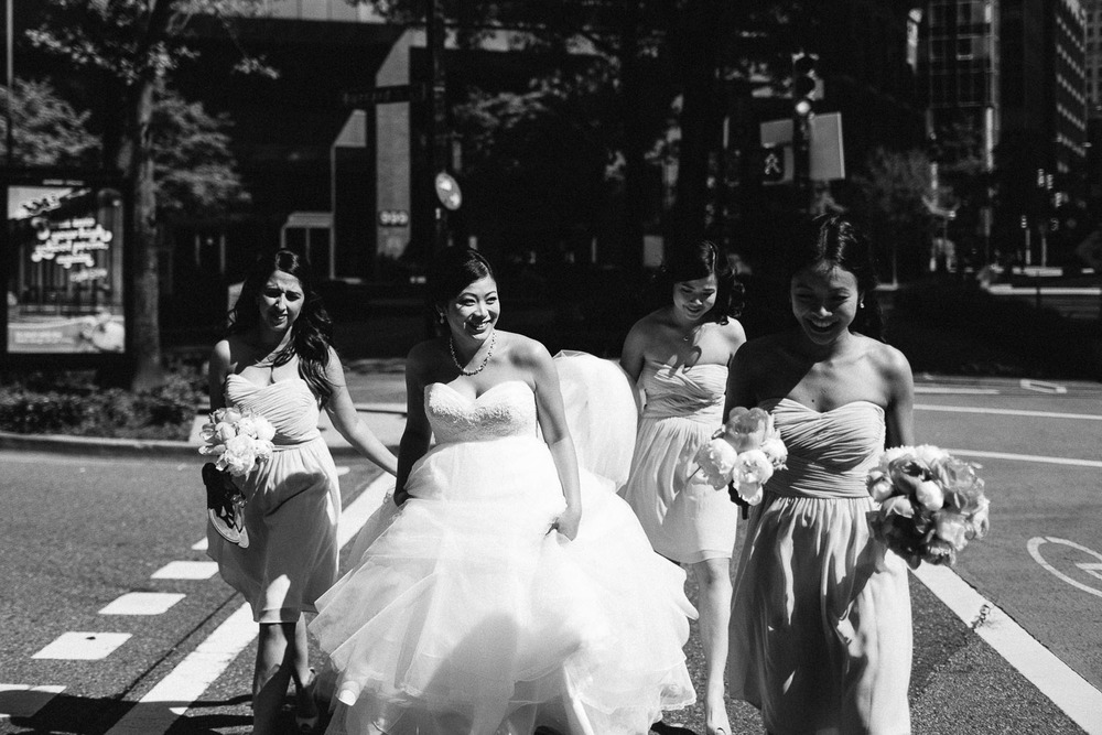 bridesmaids walking candid downtown vancouver wedding photography black and white vsco