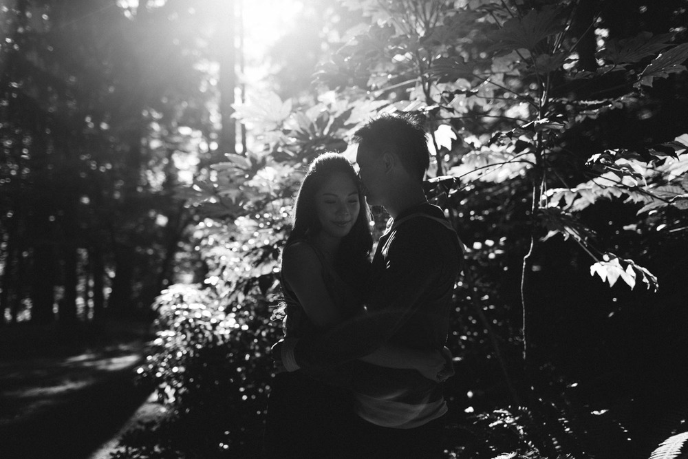 black and white engagement photography golden hour