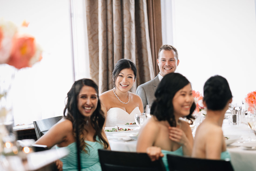 candid laughter from bride and groom at the vancouver club in coal harbour wedding photography