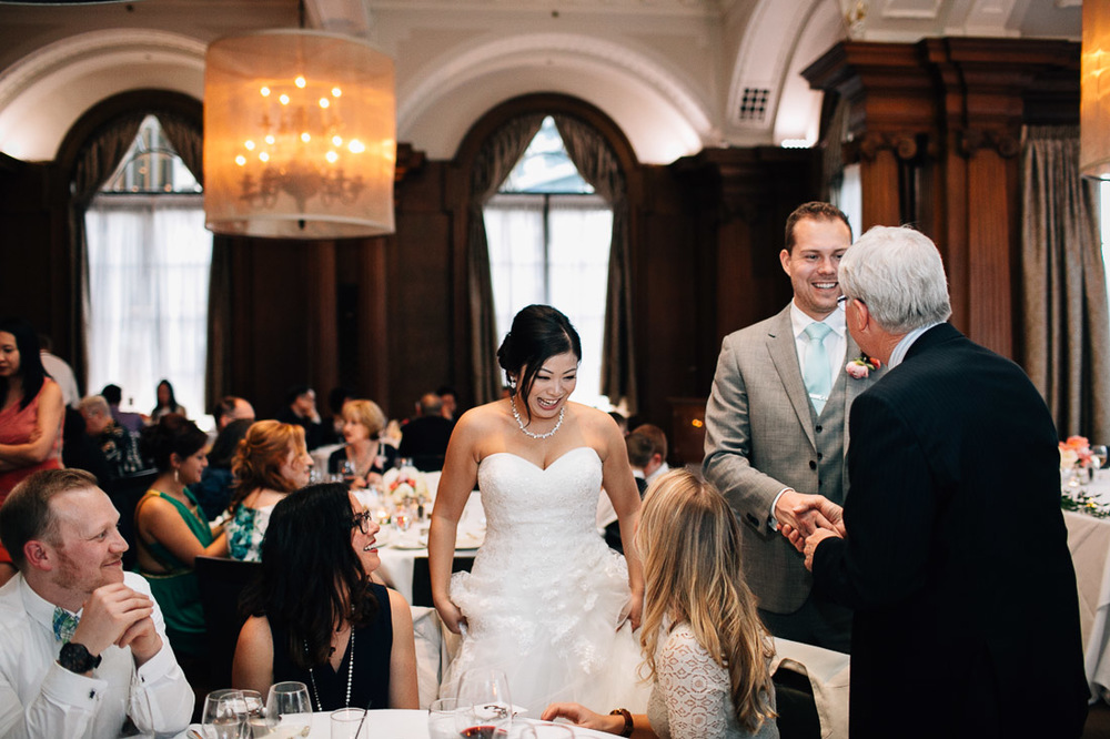 the vancouver club bride and groom interacting with guests candid wedding photography