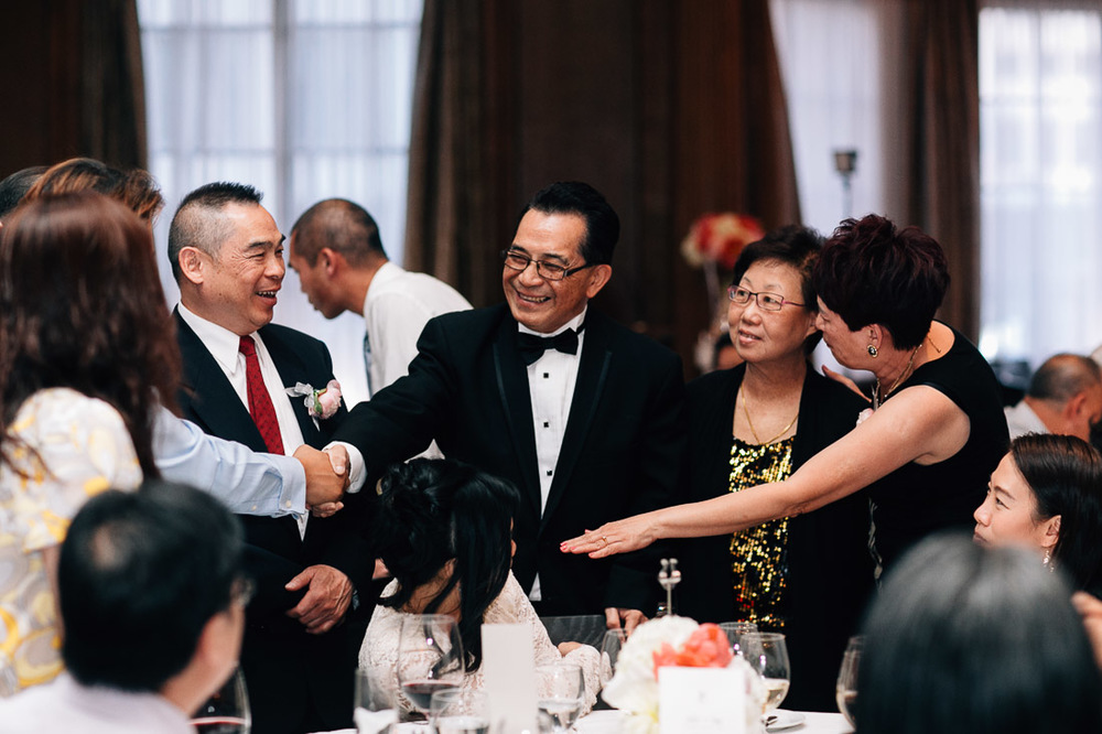 guests interacting at the reception in the vancouver club wedding photography