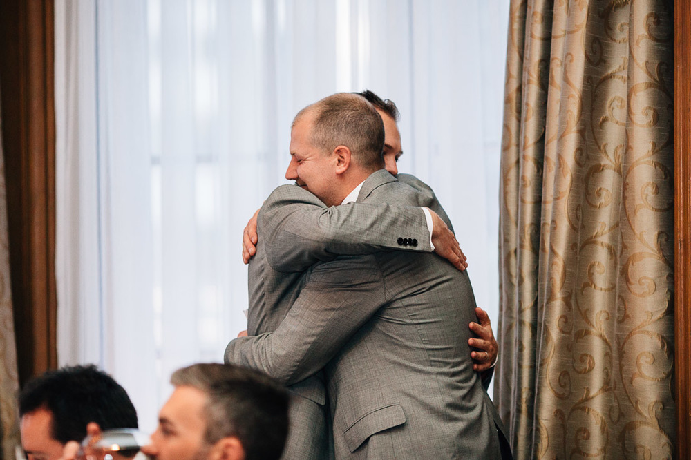 groom and brother embrace at the vancouver club reception wedding photography