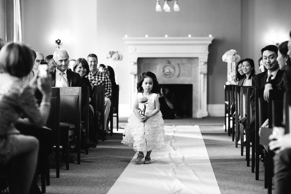 the vancouver club flower girl walking down aisle wedding photography