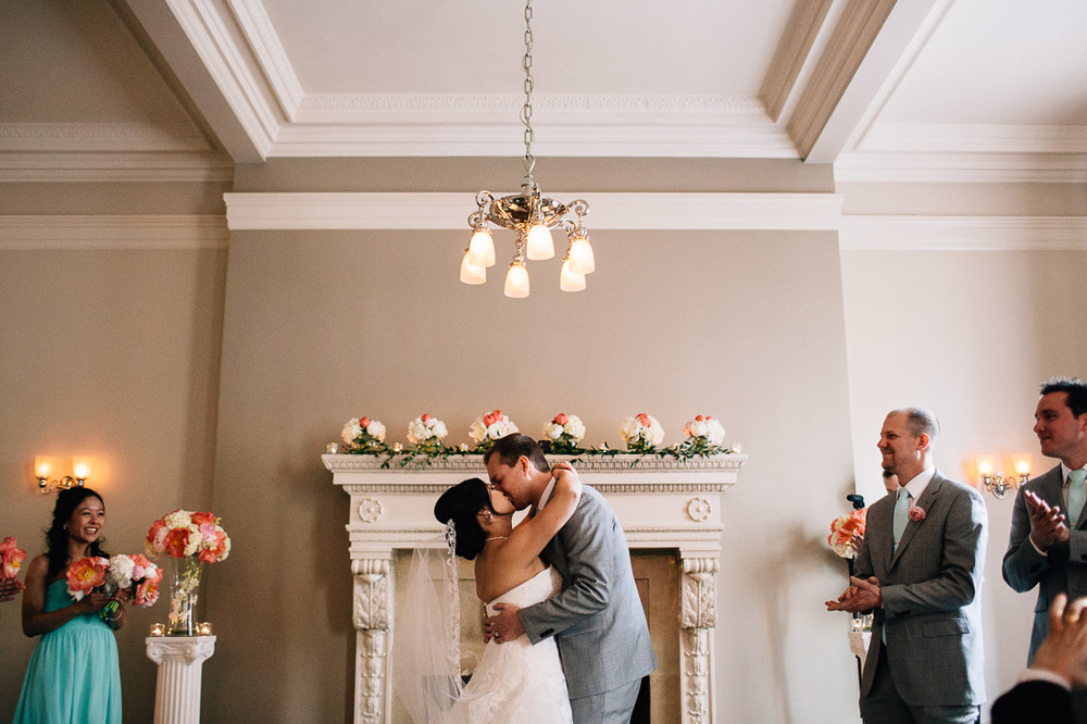 the vancouver club bride and groom kiss ceremony photography