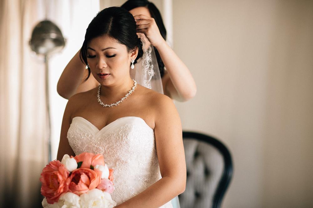 bridesmaid putting on veil for bride portrait vancouver wedding photographer