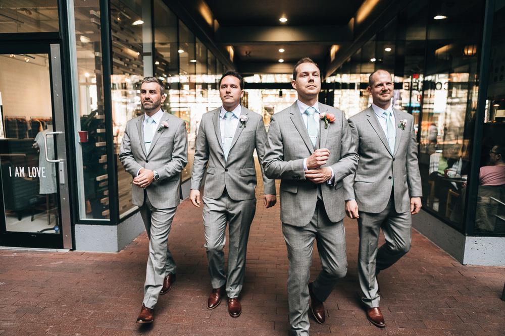 groomsman walk indochino gastown vancouver wedding photographer