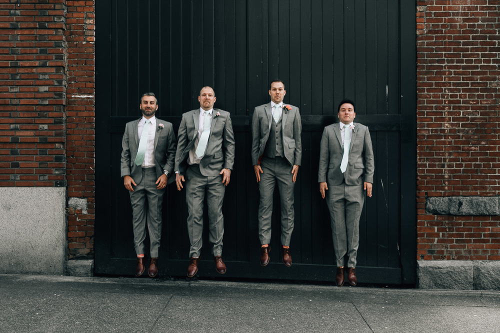 groomsman candid fun in gastown vancouver wedding photography
