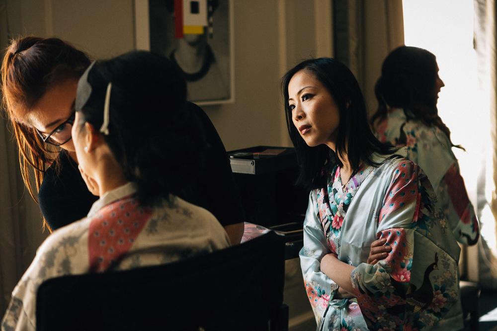 bridesmaid checking bride's wedding makeup at the vancouver club